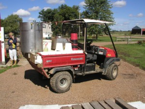 An off-road vehicle can be used to transport people, implements and material around the farmstead, while reducing strain on the body.