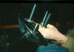 A Modified Steering Wheel is an option for farmers who have difficulties controlling traditional steering wheels on farm equipment.
