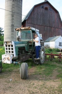 Getting into and out of tractors can be difficult with limitations, but adding an extra step and some hand rails makes it much easier on the back and hips.
